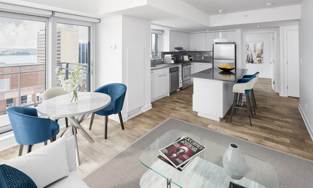Dining room and kitchen with stainless-steel appliances at 19Twenty Apartments in Halifax, Nova Scotia