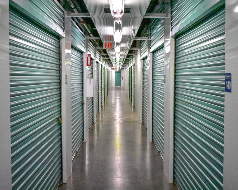 Green doors on interior climate-controlled storage units at STOR-N-LOCK Self Storage in Palm Desert, California