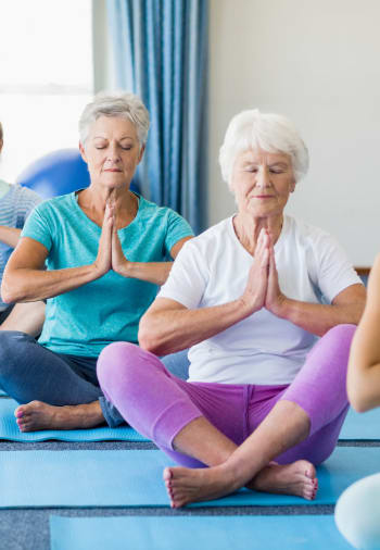 Residents practicing yoga at The Claiborne at Hattiesburg Independent Living in Hattiesburg, Mississippi.