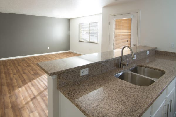 Kitchen and Living room at apartments at Ridgeview Apartments