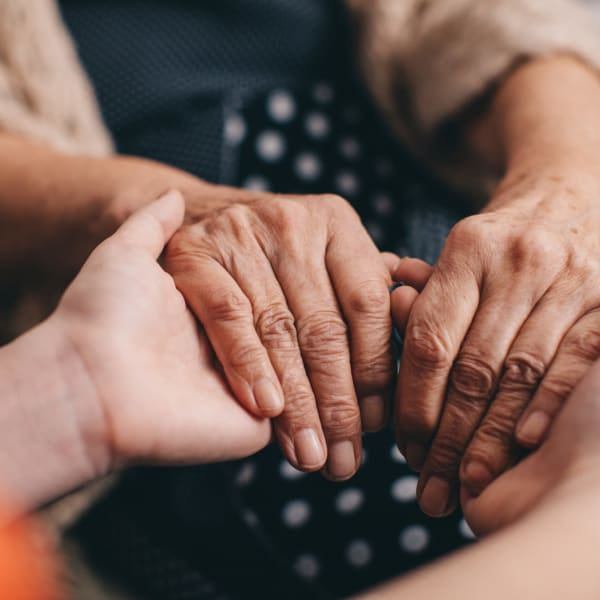 Holding hands at Pacifica Senior Living Menifee in Sun City, California.
