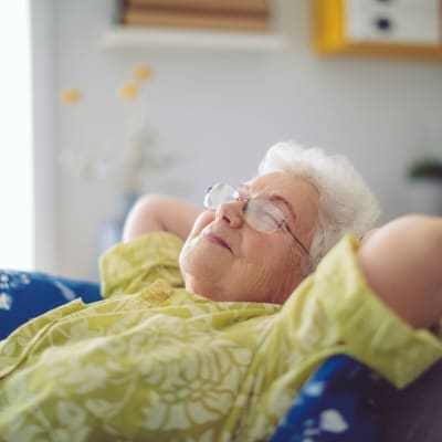 relaxed resident laying back in a chair at Deer Crest Senior Living in Red Wing, Minnesota