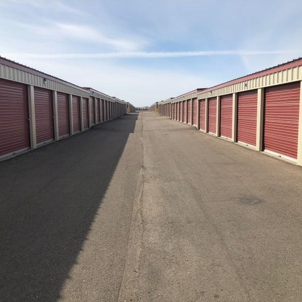Red doors on outdoor units at StorQuest Self Storage in Williston, North Dakota