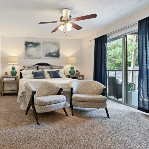 Spacious primary bedroom with a private balcony outside a model home at Crest at Riverside in Roswell, Georgia