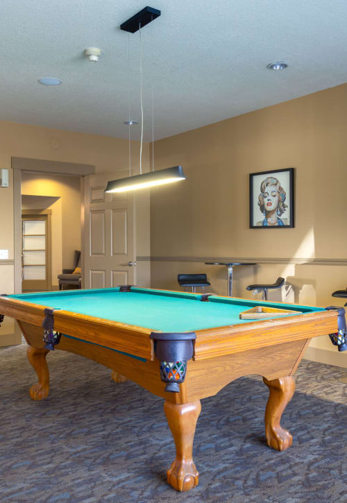 pool table game room at The Landings at Morrison Apartments in Gresham