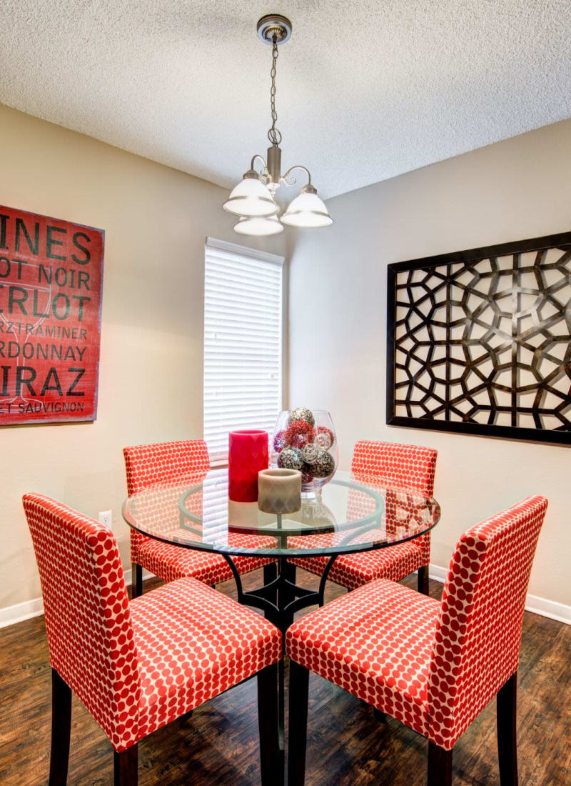 Bright dining area with a glass table at The Park at Flower Mound in Flower Mound, Texas