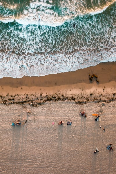 People on a the beach near a San Diego Self Storage location