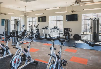 Cardio machines and more in the fitness center at Evolv in Mansfield, Texas