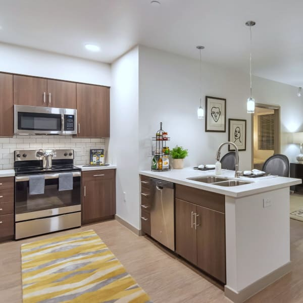 Gourmet kitchen with stainless-steel appliances at Arista at Ocotillo in Chandler, Arizona