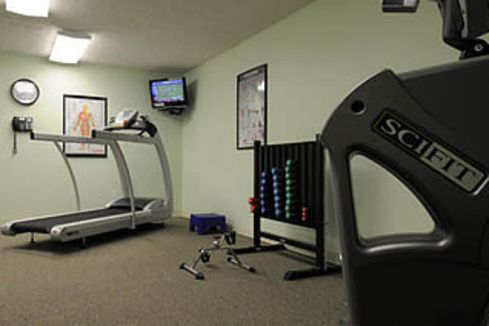 Resident exercise room with equipment at Willow Creek Senior Living in Elizabethtown, Kentucky.