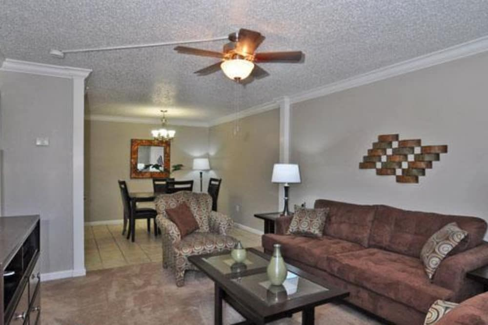 French Colony Apartments offers a modern living room in Lafayette, Louisiana