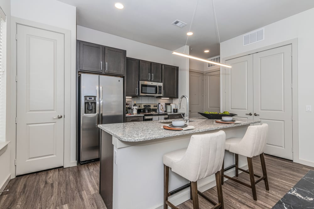 Kitchen with stainless steel appliances at Magnolia on the Green in Allen, Texas