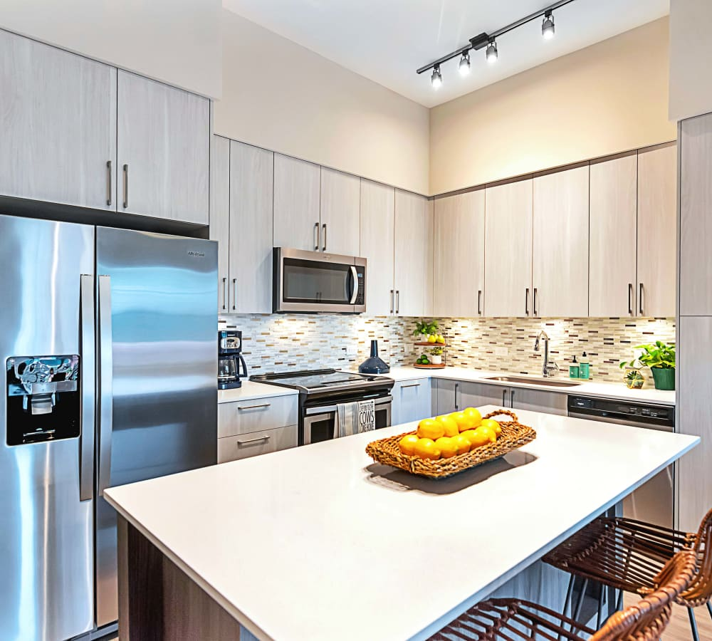 Huge island in kitchen for ample counter space when cooking at 6600 Main in Miami Lakes, Florida