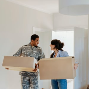 A service-member and partner moving into their new apartment in Paramount, California