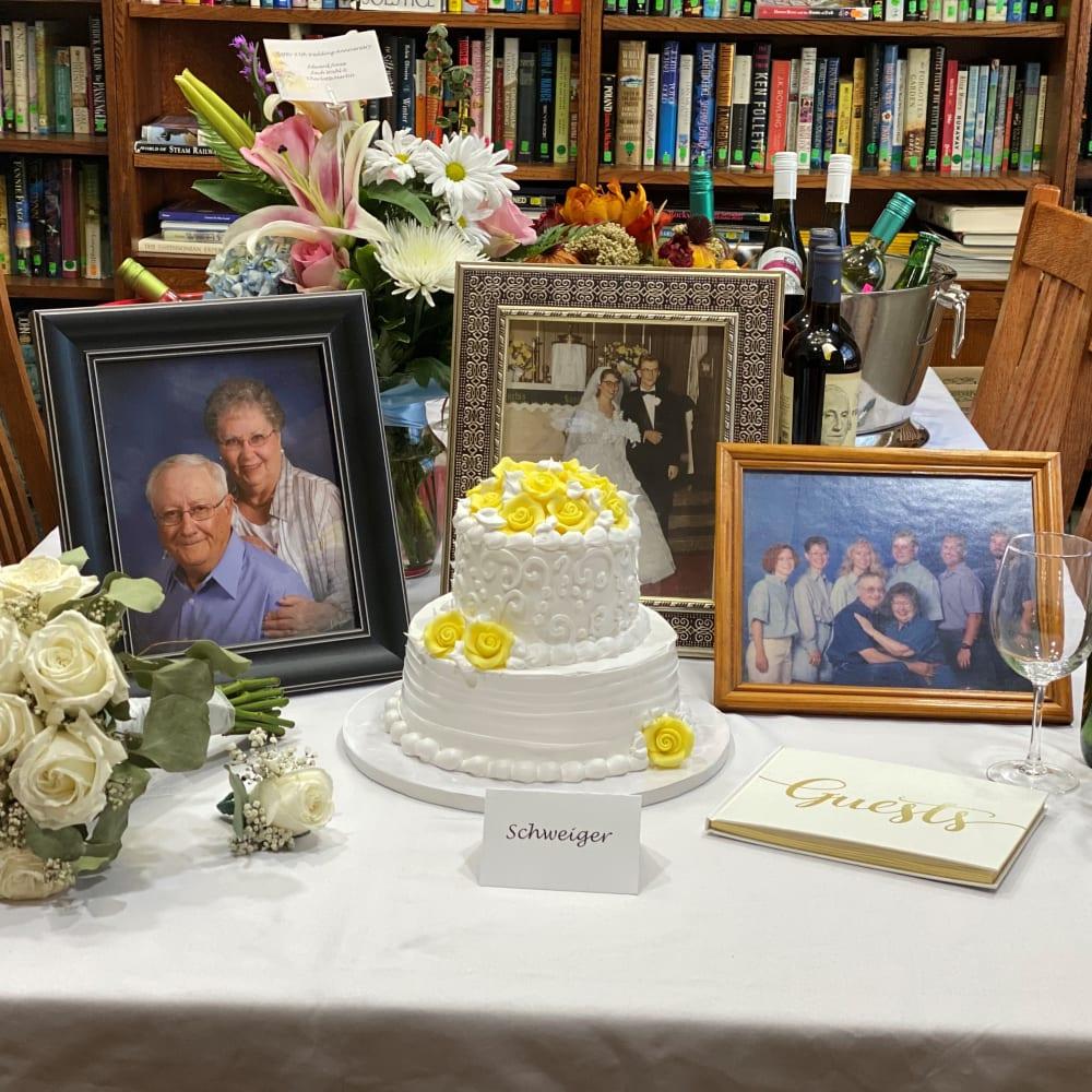 Birthday cake and photos at Glenwood Place in Marshalltown, Iowa.