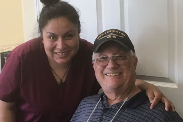 Resident and caregiver at Cypress Springs Gracious Retirement Living in Bradenton, Florida
