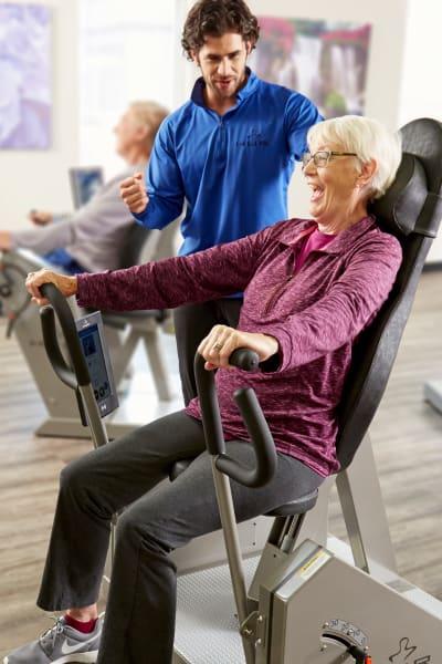 Resident using HUR fitness equipment at Quail Park at Morrison Ranch in Gilbert, Arizona