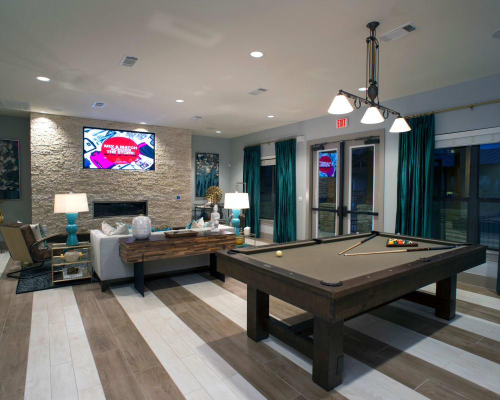 Clubhouse with a pool table at Savannah Oaks in San Antonio, Texas.