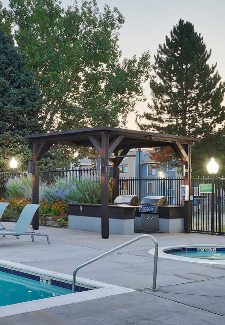 pool and exterior covered BBQ at Alton Green Apartments in Denver