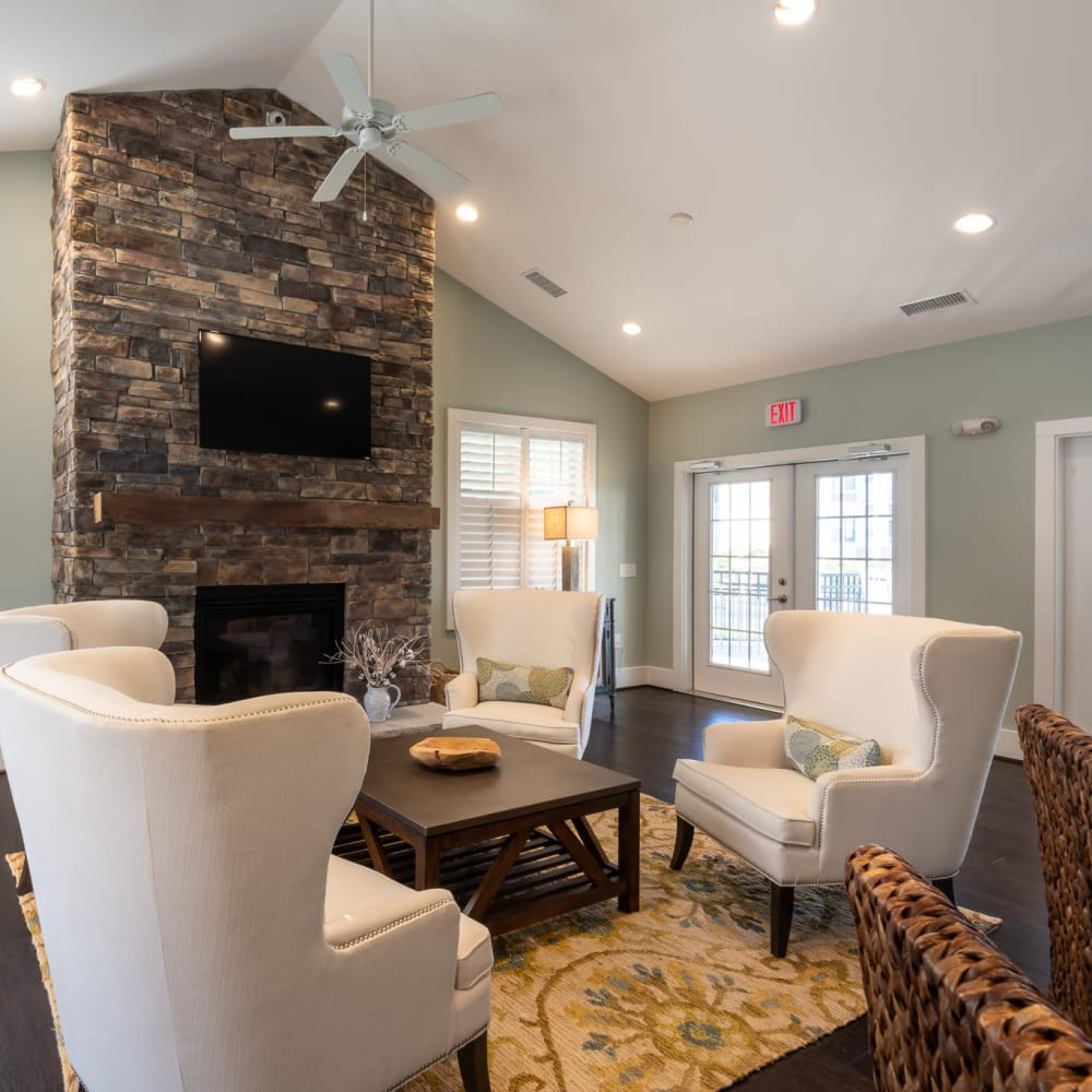 Cozy clubhouse area with firepit and lots of light at The Reserve at White Oak in Garner, North Carolina
