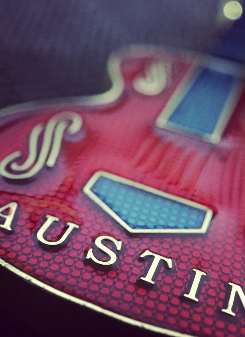 Electric Blues guitar with Austin lettering on body near Marquis at Barton Trails in Austin, Texas