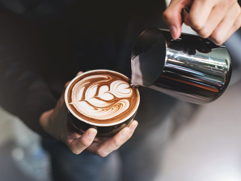 Barista making a latté for a customer near Haven New Providence in New Providence, New Jersey