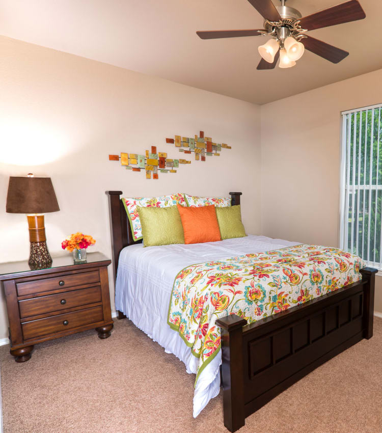 Model bedroom with a ceiling fan at Lakeview at Parkside