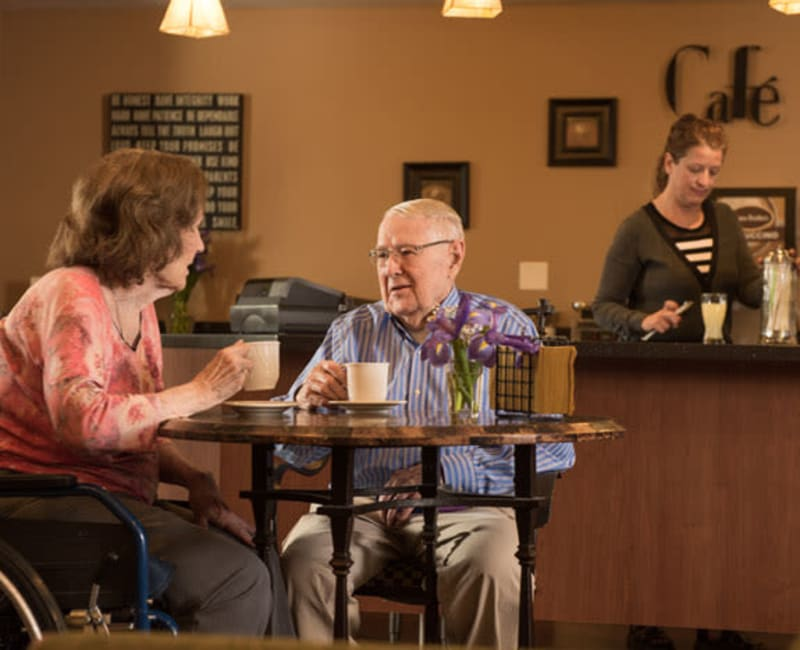 Two residents sitting in the cafe and talking at York Gardens in Edina, Minnesota