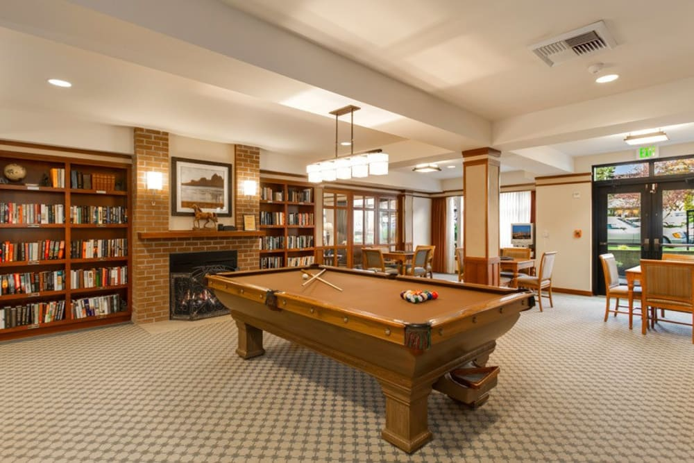 Resident game room at Merrill Gardens at The University in Seattle, Washington.