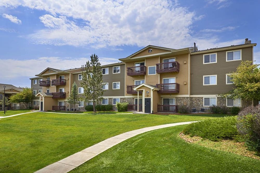 A pathway up to the exterior of Crossroads at City Center Apartments in Aurora, Colorado