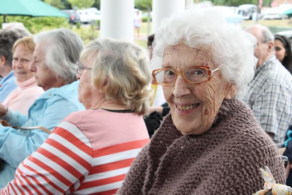 Resident at an event smiling at the camera at The Birches at Harleysville in Harleysville, Pennsylvania