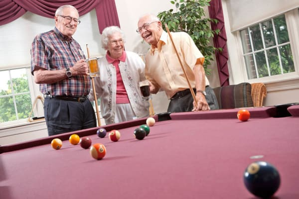 Residents hanging out together at the bar at Senior Commons at Powder Mill in York, Pennsylvania