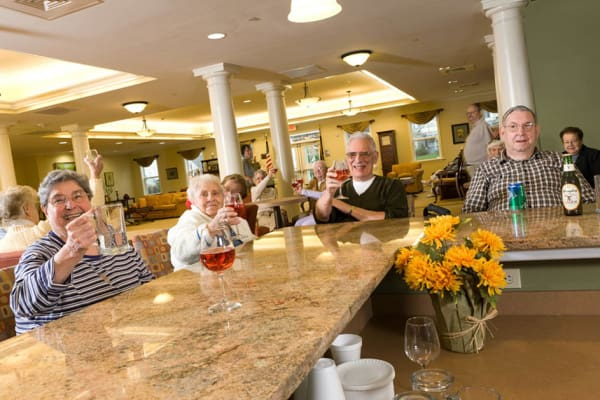 Residents hanging out together at the bar at Traditions of Hershey in Palmyra, Pennsylvania