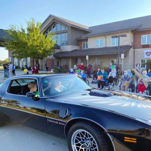 Resident riding in a muscle car outside of The Oxford Grand Assisted Living & Memory Care in McKinney, Texas