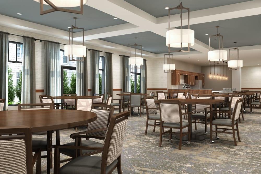 Brightly lit community dining area at Anthology of Novi - OPENING 2020 in Novi, Michigan
