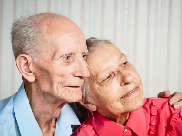 Happy couple living at Heritage Oaks Assisted Living and Memory Care in Englewood, Florida
