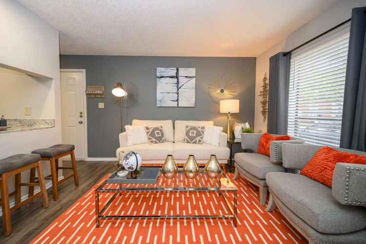 Beautifully decorated living room in a model home at The Logan in Bedford, Texas
