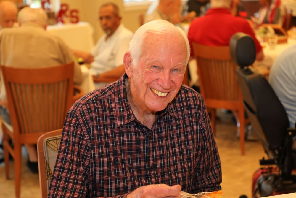 Resident smiling with friends at Merrill Gardens at Madison in Madison, Alabama