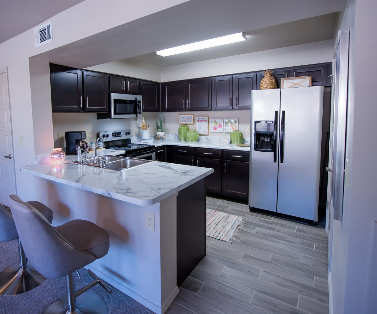 Kitchen with stainless steel appliances at Icon at Hewitt in Hewitt, Texas