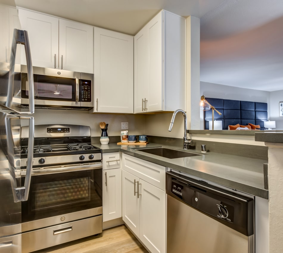 Modern kitchen with stainless-steel appliances in a model studio apartment at Vue Los Feliz in Los Angeles, California