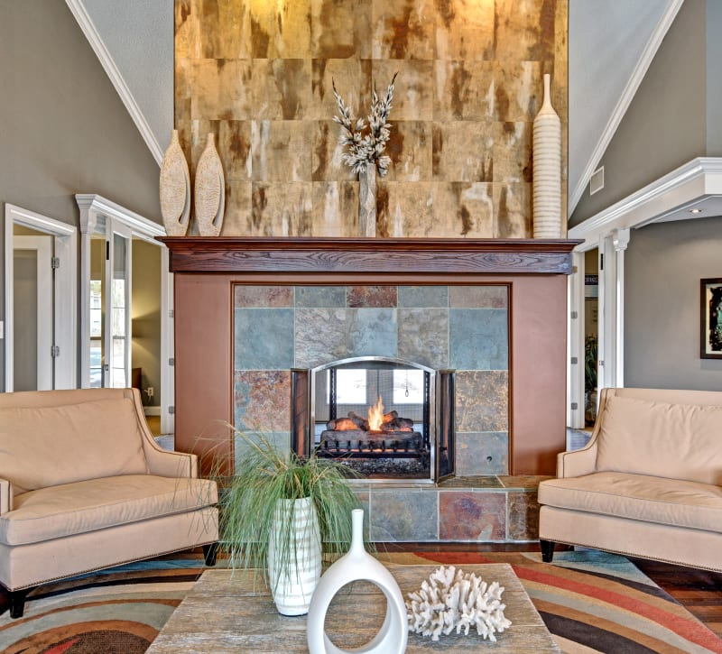 Clubhouse lounge with a fireplace at The Lakes of Schaumburg in Schaumburg, Illinois