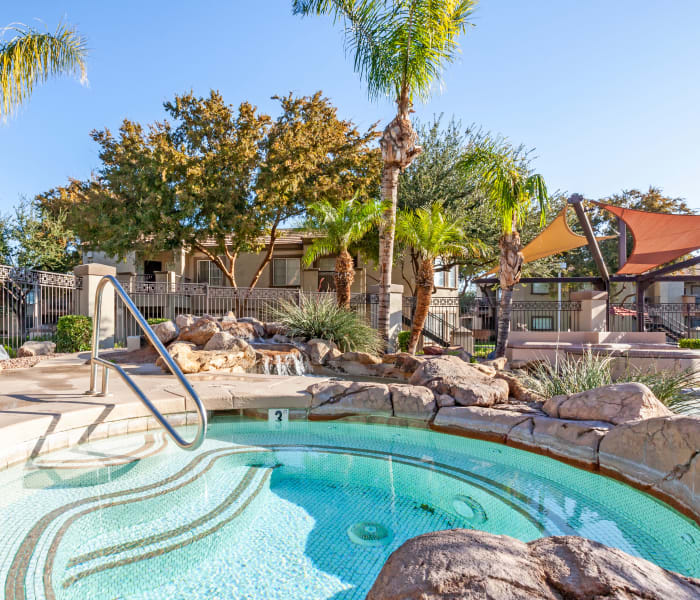 Spa surrounded by rockery and palm trees at Finisterra in Tempe, Arizona