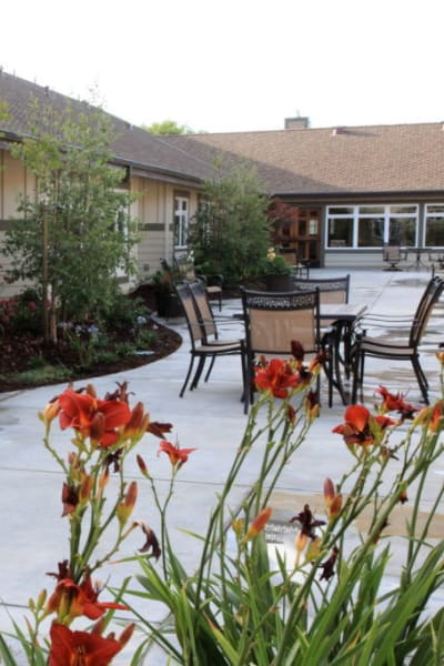 Patio with tables and chairs at Quail Park Memory Care Residences of Visalia in Visalia, California