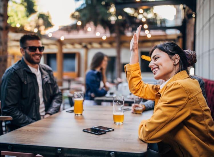 Friends enjoying some beers near Eddison at Deerwood Park in Jacksonville, Florida