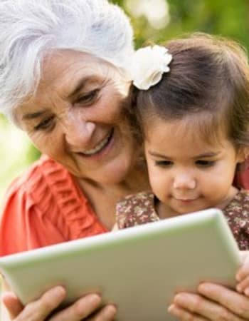Resident reading to her granddaughter at The Retreat at Lady's Island in Beaufort, SC