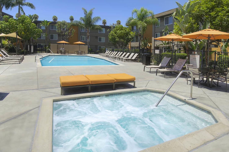 Swimming pool and hot tub at UCA Apartment Homes in Fullerton, California