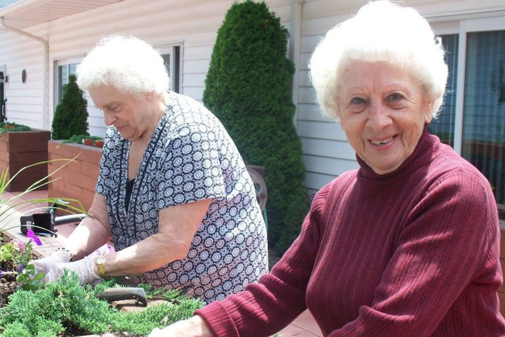 Two residents gardening at Heritage Hill Senior Community in Weatherly, Pennsylvania