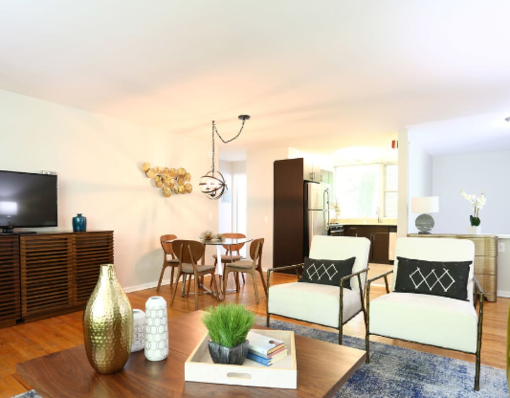 Living room with wood-style flooring at Cherokee Apartments in Philadelphia, Pennsylvania