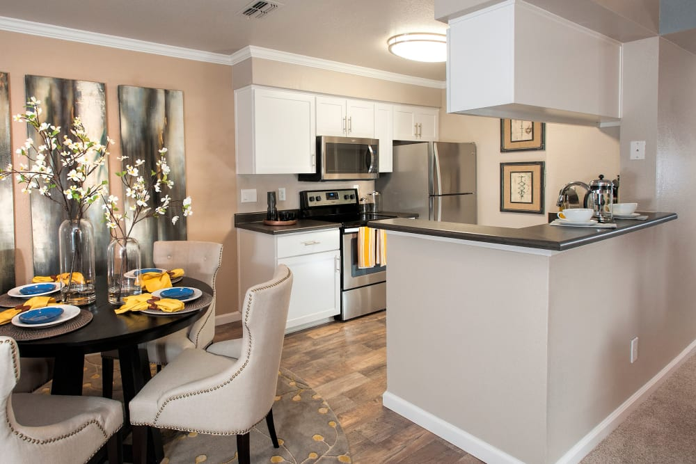 Apartment kitchen with stainless-steel appliances at The Reserve at Capital Center Apartment Homes in Rancho Cordova, California