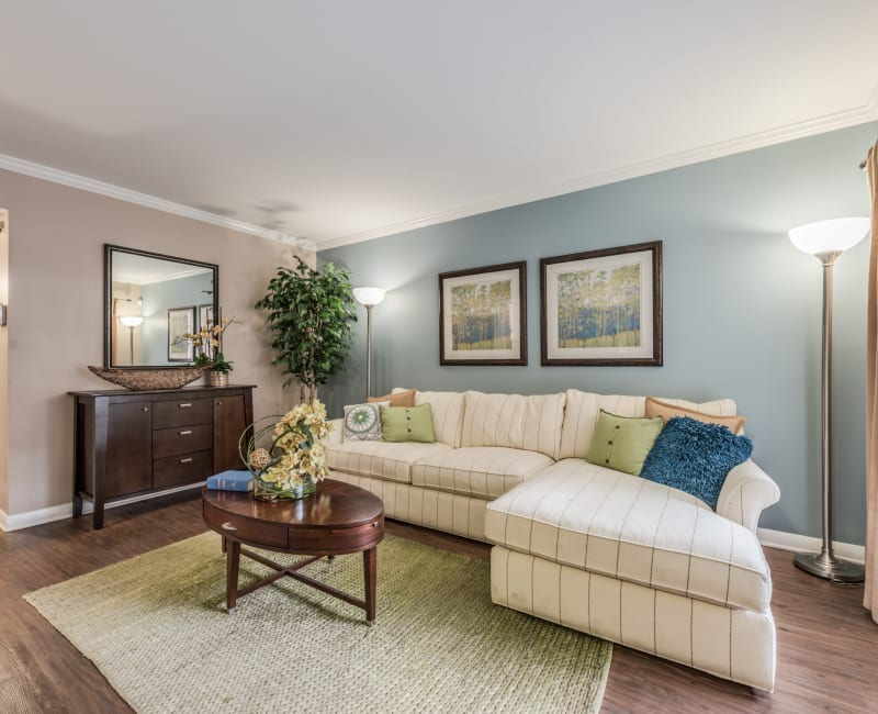Bright and spacious living room with hardwood flooring at The Villages at Meyerland in Houston, Texas